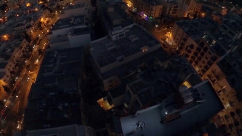 Night city from a bird's-eye view. Aerofutazh. Malta. Guy and a girl are lying ビデオ