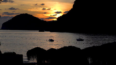 Sunset in a sea bay with boats. Time lapse Footage