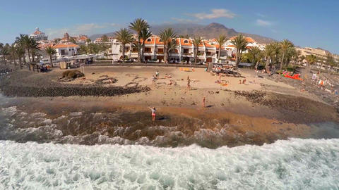 Top view of the beach with hotels and the ocean. Girl rejoices and greets the Footage