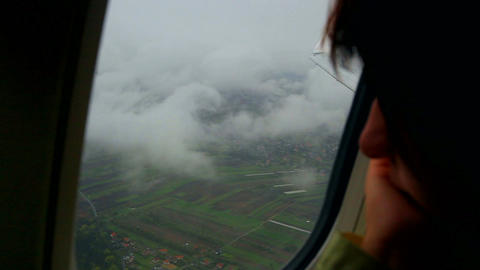Girl looking out the window of an airplane. enerife Live Action