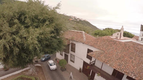 Aerial view on the city landscape. car rides in a cozy yard near the ocean Footage