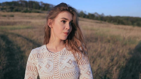 Portrait of beautiful girl on meadow background GIF