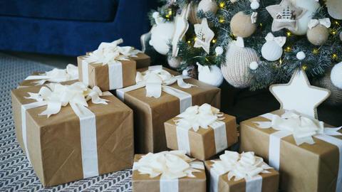 Pan shot of Christmas tree and gift box decoration at home ビデオ
