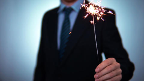 a businessman in a suit holds a firework, a Bengal fire. Christmas and New Year Footage