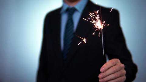 Sparkler in the hands of a businessman. holidays, christmas and new year in Footage