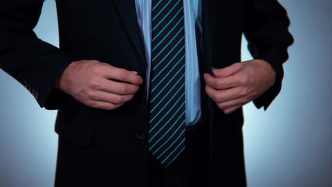 slow motion, businessman buttoning his jacket Footage