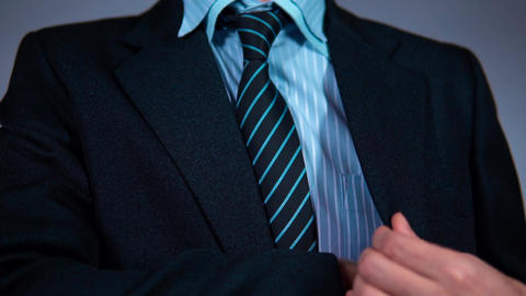 slow motion, businessman in the office pulls the phone out of his jacket pocket Archivo