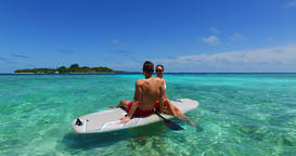 v11360 two 2 people romantic young people couple paddleboard surfboard with Live Action