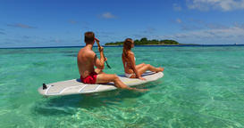 v11316 two 2 people romantic young people couple paddleboard surfboard with Live Action