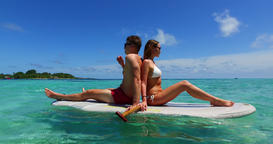 v11324 two 2 people romantic young people couple paddleboard surfboard with Footage