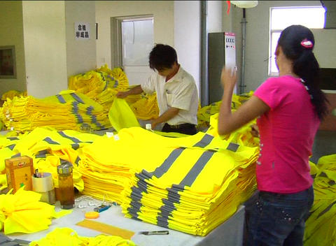 Factory workers folding jackets Footage