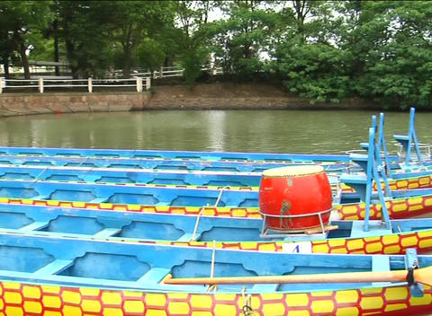Dragon boats moored on lake Stock Video Footage