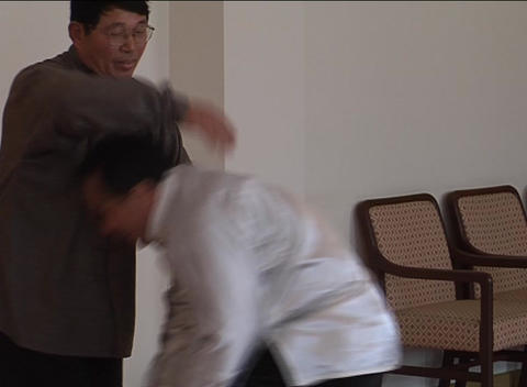 Two martial artists sparring inside Stock Video Footage