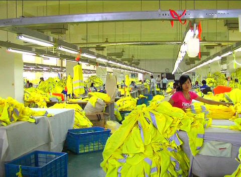 Factory workers on assembly line Footage
