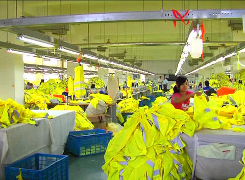Factory workers on assembly line Stock Video Footage