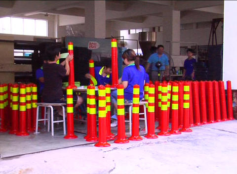 Factory workers assembling traffic cones Footage