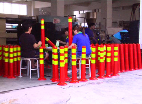 Factory workers assembling traffic cones Stock Video Footage