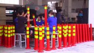 Factory Workers Assembling Traffic Cones stock footage