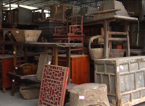 Unrestored Chinese antique furniture in storage Stock Video Footage