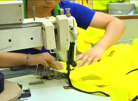Factory worker sewing jacket Footage