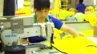 Factory Worker Sewing Jacket stock footage