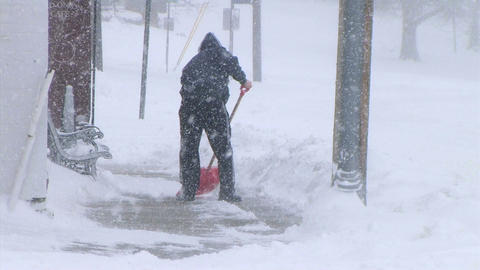Man Shoveling Snow Footage