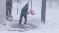 Man Shoveling Snow stock footage