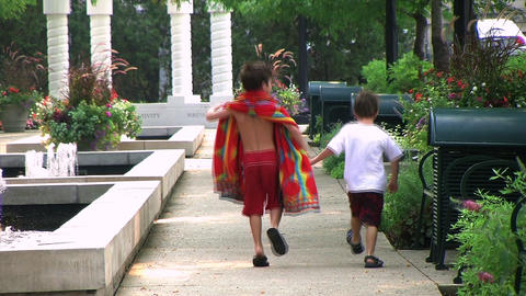 Boys Skipping in Park Stock Video Footage