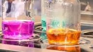 Laboratory Beakers With Different Coloured Chemicals stock footage