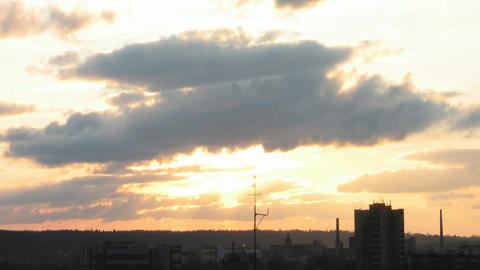 Time-lapse of clouds above industrial area at sunset 1 Stock Video Footage