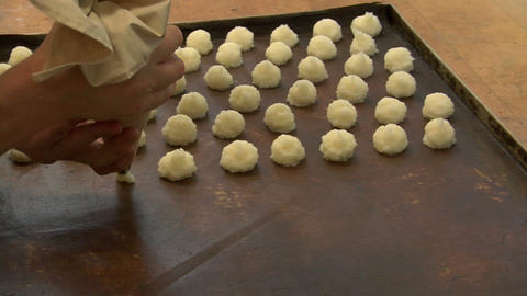 german bakery squirt coconut macaroons onto plate wide 10750 Stock Video Footage