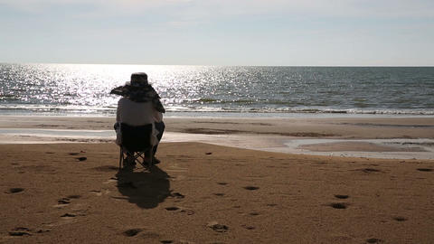 Senior man sitting at beach Footage