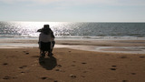 Senior Man Sitting At Beach stock footage