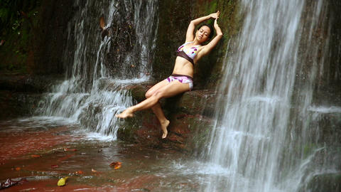 Sexy dancer on waterfall in rainforest Footage