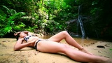 sexy girl lying down in river Footage