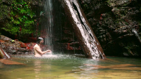 caucasian man enjoying in waterfall Footage