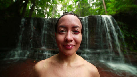 Tribal girl in jungle waterfall Footage