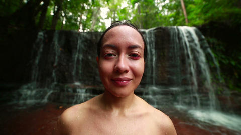 Tribal girl in jungle waterfall Stock Video Footage