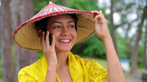 Asian woman talking on phone Stock Video Footage