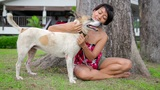 Asian woman exercise her dog Footage