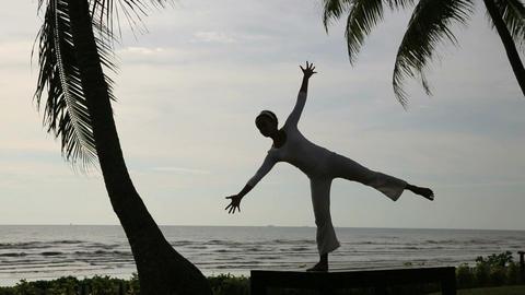 silhouette yoga meditation at beach Footage