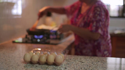 Mother preparing food at kitchen Stock Video Footage