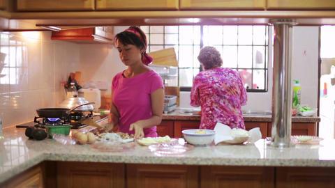 Mother daughter preparing meal together Footage