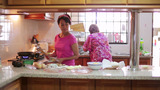 Mother Daughter Preparing Meal Together stock footage
