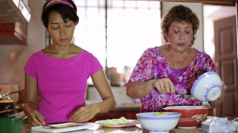 Mother daughter preparing meal together Footage