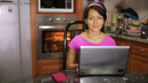 woman with laptop in kitchen Footage