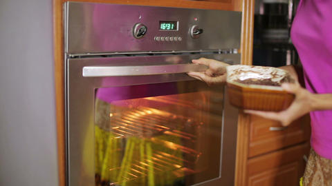 Cooking in oven Stock Video Footage