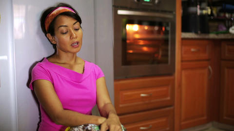 funny woman cooking in kitchen Stock Video Footage