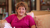 Senior Woman Sitting At Living Room stock footage