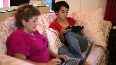 Mother daughter using tablet computer Footage
